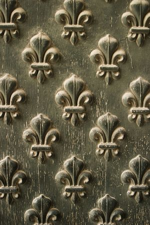 Fleur-de-lis pattern from the doors to Napoleons Tomb in Paris. The paint is peeling due to weathering.