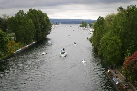 canal parade: In Seattle, every year, Opening Day in May marks the start of the annual boating season on Lake Washington with crew races and a long boat parade through the ship canal. Coincidentally, it is usually cloudy too!