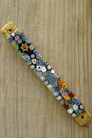 mezuzah: A Mezuzah on an old wood door post