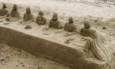 A sand sculpture of the Last Supper on a beach in Mexico Stock Photo