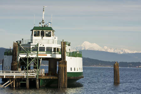 mt  baker: A ferry boat tied up at dock with the snow covered Mt. Baker in the background. Stock Photo