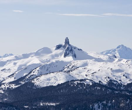 phallic: Black Tusk is a pristine pinnacle of volcanic rock located in Garibaldi Provincial Park of British Columbia, Canada. At 2,319 metres above sea level, the upper spire is visible from all directions, including the summit of Mount Whistler. The Black Tusk is Stock Photo