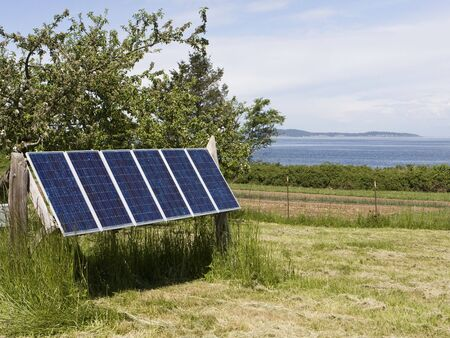 A set of solar panels located on an island provide a source of renewable energy. Imagens