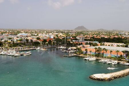 aruba: A view of the main harbor on Aruba looking inland. This photo, from a cruise ship, looks down over the city and boats.