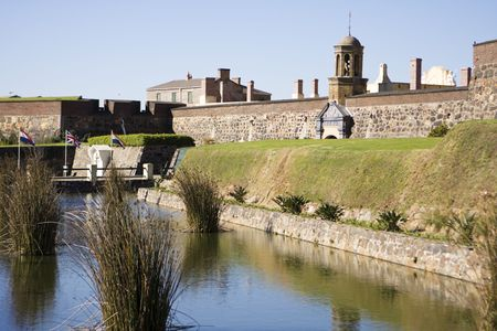 The Castle of Good Hope is the oldest building in Cape Town, South Africa. The old fortress is surrounded by a moat with the original entrance to the right. photo