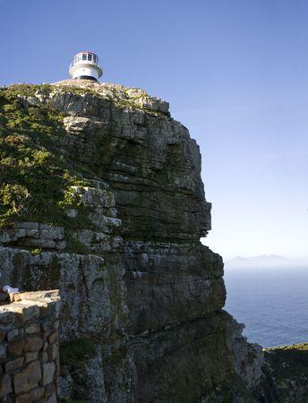 El viejo faro en Cabo punto, Sudáfrica es un faro que ayuda a los buques navegar por el Cabo de Buena Esperanza entre los océanos Índico y Atlántico.  Foto de archivo - 3604761