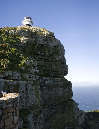 The old lighthouse at Cape Point, South Africa is a beacon that helps ships navigate around the Cape of Good Hope between the Indian and Atlantic Oceans. Stock Photo - 3604761