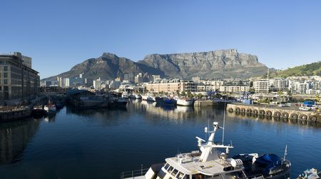 cape town: Panorama skyline view of Cape Town, South Africa with the harbor in the foreground and Table Mountain in the background.