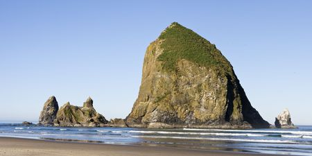 Haystack Rock, on Cannon Beach, Oregon is one of the largest sea stacks on the west coast of the United States. photo