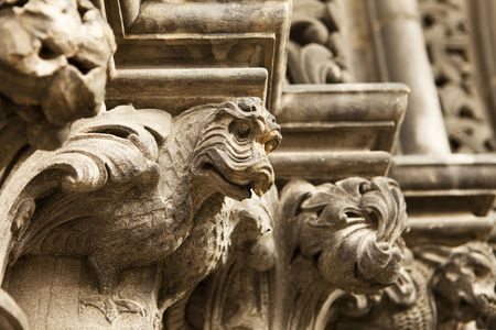 giles: A steries of dragon gargoyles carved in stone line the main entrance door to St. Giles Cathedral in Edinburgh, Scotland.  Stock Photo