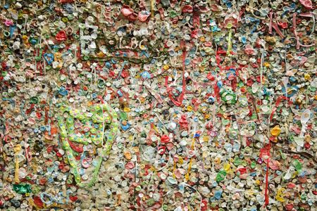 show off: Details of a colorful wall covered in bubble gum deposited over the years in the Post Alley section of the Pike Place Market in Seattle show off a gross and disgusting landmark in Seattle.