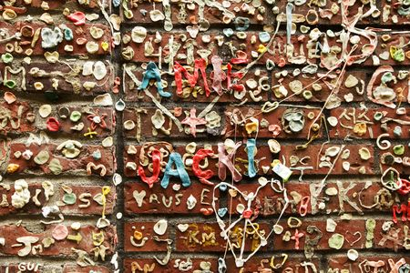 A small section of graffiti created on a brick wall in Post Alley near the Pike Place Market in Seattle. Imagens