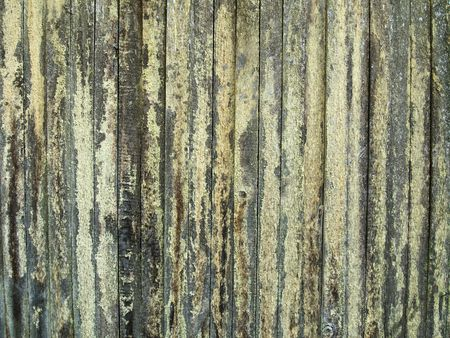 An old wood fence is in need of cleaning with much lichen on it. A nice background.