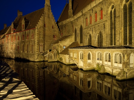 A view of St. John's Hospital in Bruges, Belgium as seen from across the canal at night. Stock Photo - 8820237