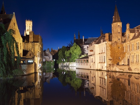 One of the main canals at night with nice reflections from the water. The landmark carillon, or belltower, at Market Square is visible in the upper left. Stock Photo