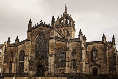 The front stone facade and main tower of the St. Giles Cathedral in Edinburgh, Scotland. The historic landmark is in the middle of the Royal Mile in the center of the city. Stock Photo
