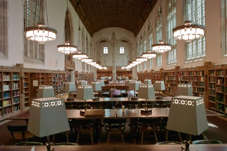 reading lamps: New Haven, Connecticut, United States - May 30, 2008: The main reading room at Yale University is full of long tables for studying.