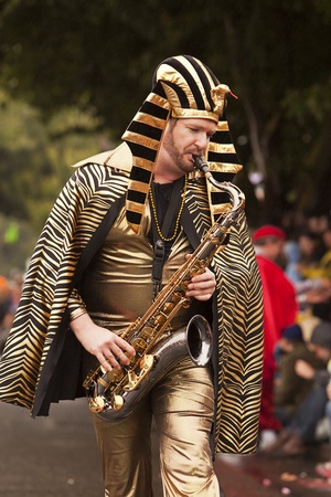 nontraditional: Seattle, Washington - June 18, 2011:  King Tut plays the saxophone while marching in the 2011 Annual Fremont Summer Solstice Day Parade. The parade celebrates the summer solstice and features a number of alternative, non-traditional artistic ensembles. Editorial