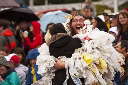 nuclear waste: Seattle, Washington - June 18, 2011:  A man, part of the Nuclear Waste Freak Show ensemble, is hugging a bystander during the 2011 Annual Fremont Summer Solstice Day Parade. The parade celebrates the summer solstice and features a number of alternative, n Editorial