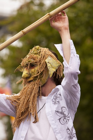 nontraditional: Seattle, Washington - June 18, 2011:  A man in an unusual mask is costumed for the 2011 Annual Fremont Summer Solstice Day Parade. The parade celebrates the summer solstice and features a number of alternative, non-traditional artistic ensembles.