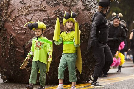 solstice: Seattle, Washington - June 18, 2011:  A performance ensemble showcasing what appears to be insects and a giant ball of dung in the 2011 Annual Fremont Summer Solstice Day Parade. The parade celebrates the summer solstice and features a number of alternati Editorial