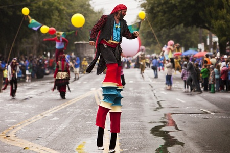 Seattle, Washington - June 18, 2011:  Members of the Fancy Pants stilt walkers group tower over the parade route at the annual Fremont Solstice Day Parade. The parade is held to celebrate the summer solstice and features a number of alternative, non-tradi