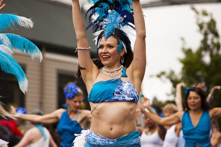 nontraditional: Seattle, Washington - June 18, 2011:  A woman dressed in blue performs during the 2011 Annual Fremont Summer Solstice Day Parade. The parade celebrates the summer solstice and features a number of alternative, non-traditional artistic ensembles.