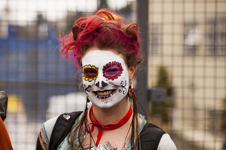 solstice: Seattle, Washington - June 18, 2011:  A spectator in full face paint and dyed hair watches during the 2011 Annual Fremont Summer Solstice Day Parade. The parade celebrates the summer solstice and features a number of alternative, non-traditional artistic