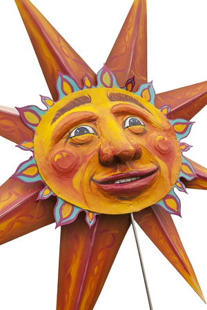 Seattle, Washington - June 18, 2011:  A great golden sun is emblematic of the 2011 Annual Fremont Summer Solstice Day Parade. The parade celebrates the summer solstice and features a number of alternative, non-traditional artistic ensembles. (Isolated to