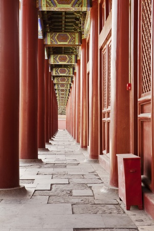 people's cultural palace: A long colonnade of red pillars along the West building of the Taimiao Ancestral Temple in Beijing, China. The temple is now the Peoples Cultural Palace.