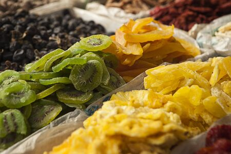 A display of dried fruits including kiwis, ginger and other delicacies at a fruit stand near the Great Wall of China at Mutianyu. Stock Photo