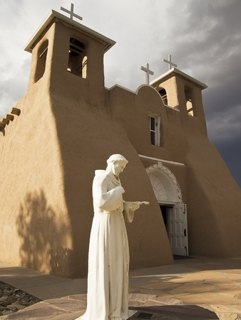 francis: A marble statue of St. Francis in contemplation stands in front of the San Francisco de Asis Mission Church in Rancho de Taos in New Mexico. Stock Photo