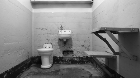 alcatraz: Alcatraz, California - December 28, 2007 - The interior of an empty prison cell at Alcatraz Federal Penitentiary. Now a National Park, this bleak cell is sparsely furnished. (In black and white.)