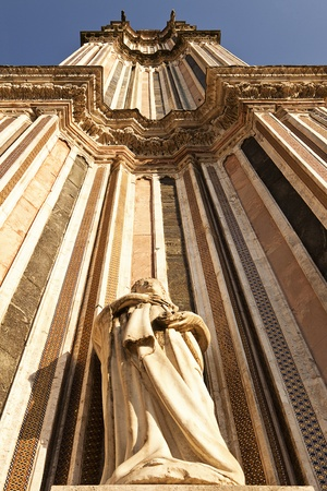 orvieto: A view looking upwards to the top of one of the twin belltowers of the main cathedral, the Duomo, in Orvieto. The extreme perspective foreshortens the tower. Stock Photo
