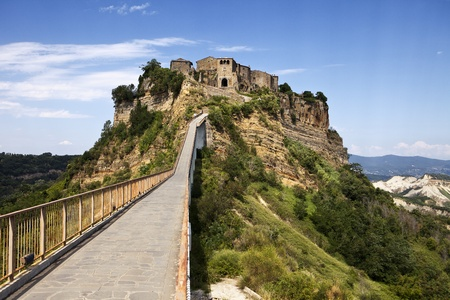 The passenger bridge crosses a long gully and is the only way to visit the hill town of Civita, Italy. Stock Photo - 12009031