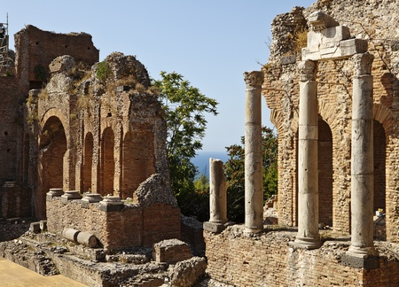 taormina: The ruins of the ancient Roman theatre, or Teatro Antico, in Taormina, Italy still stand and the main walls, or edificio sceneo, are still in good condition. The theater is still used for modern performances.