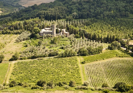 A scenic viewpoint of an old monastery estate surrounded by olive orchards and vineyards in the hilly countryisde of Umbria near Orvieto in Italy. photo