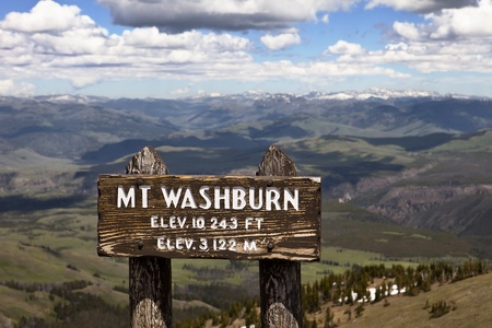elevation: The sign at the summit of Mt. Washburn which, at an elevation of 10,243 feet, is the highest point in Yellowstone National Park. Stock Photo