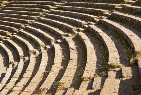 A section of the stone seating area in the Teatro Antico theater. The old Greek and Roman theatre is still used for musical or other performances.
