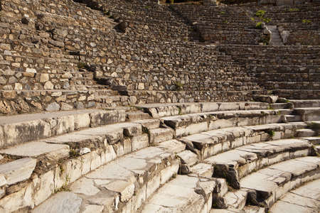 Rows of marble stone seats rise up in the ancient Greek theater at Ephesus in Turkey  There are two theaters in Ephesus and this is the small theatre  photo