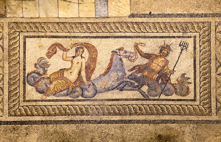 Ephesus, Izmir, Turkey - July 15, 2011:  An ancient floor mosaic shows an image of Poseidon riding with Ampitrite, his wife or consort, on the sea horse Hippokampos. This floor mosaic is on display in the hillside houses of Ephesus.