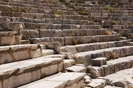aisles: A section of seats in the old Roman theater at Ephesus near Izmir in Turkey  There are two aisles leading up through the tiers of stone seats  Stock Photo