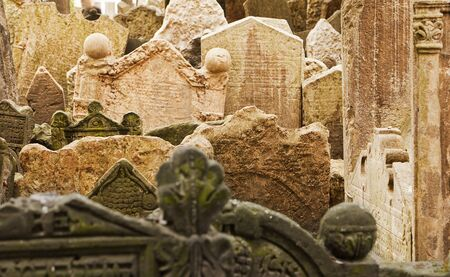 cemetery: Gravestones in the historic cemetery in the Josefov ghetto area of central Prague tilt and lean together as they have settled over centuries  Stock Photo