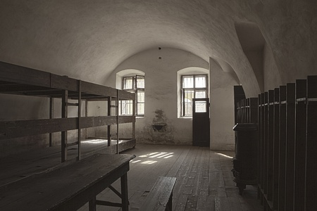 Terezin, Czech Republic - October 8, 2010:  One of the dormitory rooms in the Little Fortress at Terezin. Used as a transit and prison camp in World War II by the Germans, this room held approximately 50 people in the bunks on the left.