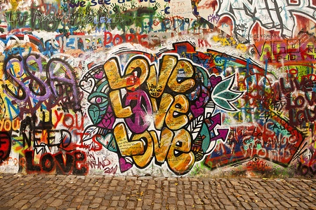 graffiti: Prague, Czech Republic - October 7, 2010: A section of the Lennon Wall in the Little Town area of Prague near the Charles Bridge. This landmark wall is open to public graffiti in remembrance of John Lennon. Editorial