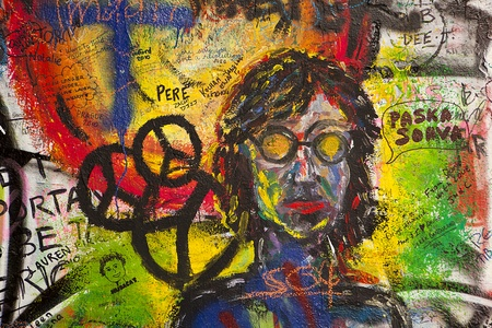 Prague, Czech Republic - October 7, 2010:  A portrait of John Lennon with peace symbols is a small detail in the graffiti on the Lennon Wall in the Little Town of Prague near the Charles Bridge.This landmark wall is open to public graffiti in remembrance
