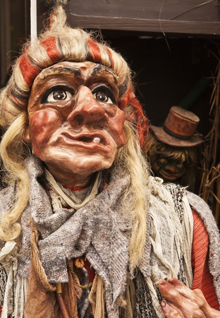 rendition: A puppet rendition of a witch is a caricature with a single tooth and dressed in rags  The detailed carved figure with wig and hand painted features is a traditional Czech craft style