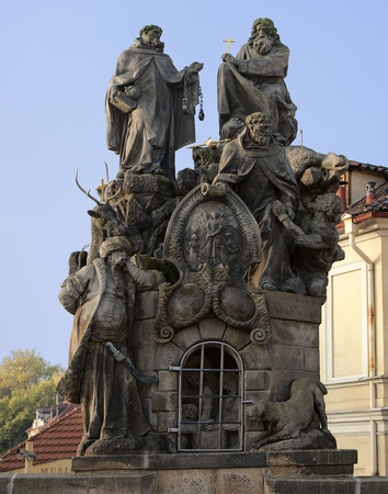 redeeming: Statues of Saints John of Matha, Felix of Valois, and Ivan on the Charles Bridge in Prague  Designed in 1714, the sculpture honors the two founders of the Trinitarians, the order that supervised buying back and redeeming of Christians in captivity under T Editorial