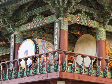 Two of the huge drums at the Bongeunsa Buddhist Temple in Seoul, South Korea  The drums are kept in a building that is painted in bright decorative colors  Stock Photo