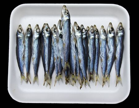 A tray of anchovies on a tray at a Japanese fish market in Tokyo.